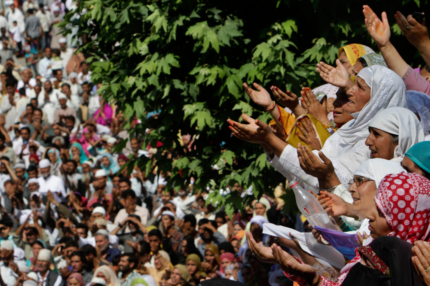 July 1, 2011. Kashmiri Muslim women pray as the head priest, unseen, displays a holy relic believed to be a hair from the beard of Prophet Mohammed, at the Hazratbal Shrine, on the outskirts of Srinagar, India. Devotees thronged the Hazratbal shrine on the second day of the Muslim festival of Mehraj-u-Alam, believed to mark the ascension of Prophet Mohammed to Heaven.