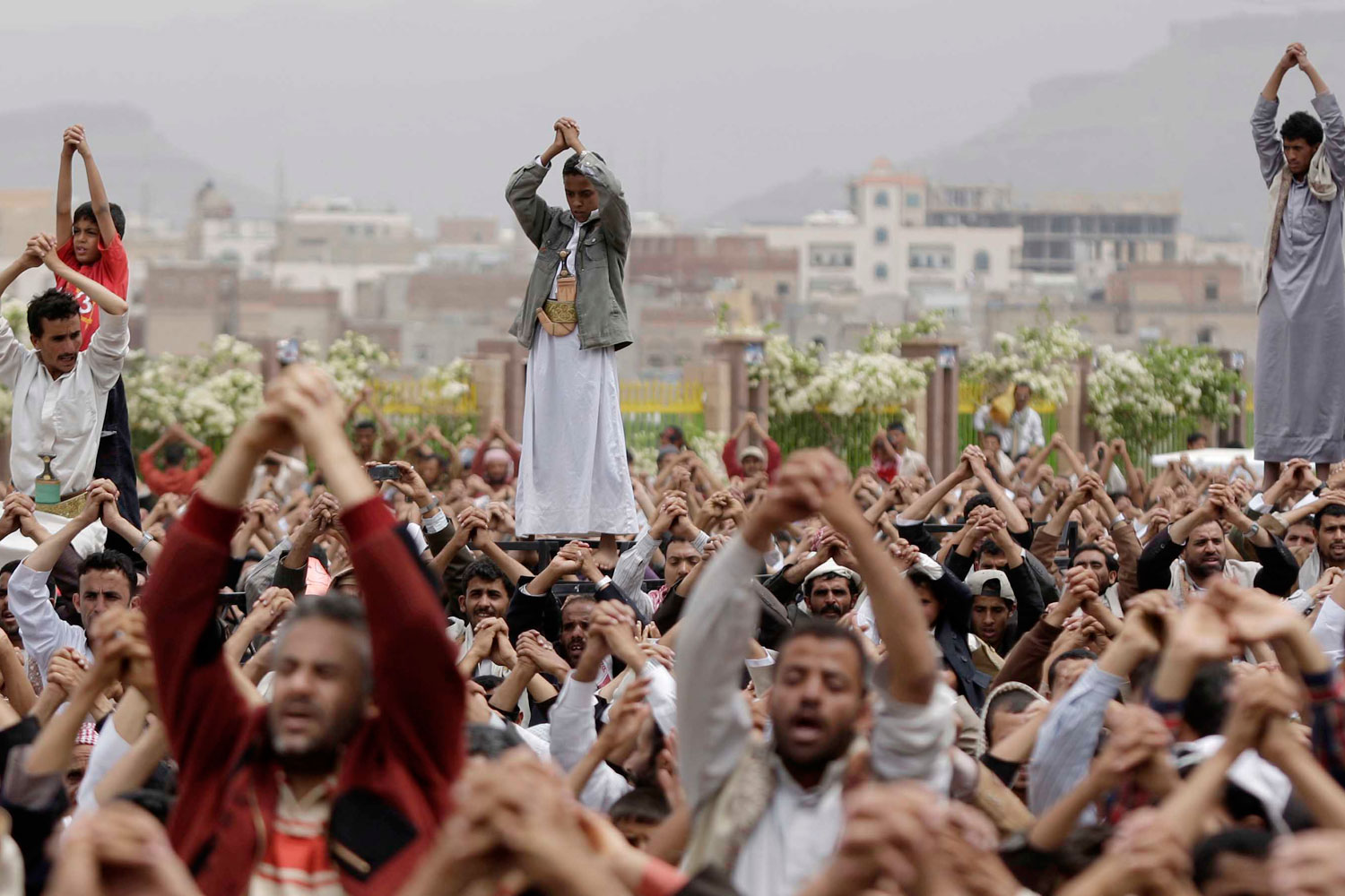 July 1, 2011. Anti-government protestors gesture during a demonstration demanding the resignation of Yemeni President Ali Abdullah Saleh, in Sanaa, Yemen. Military officials say dozens of Yemeni officers suspected of turning against embattled President Ali Abdullah Saleh have been arrested under orders from his son.