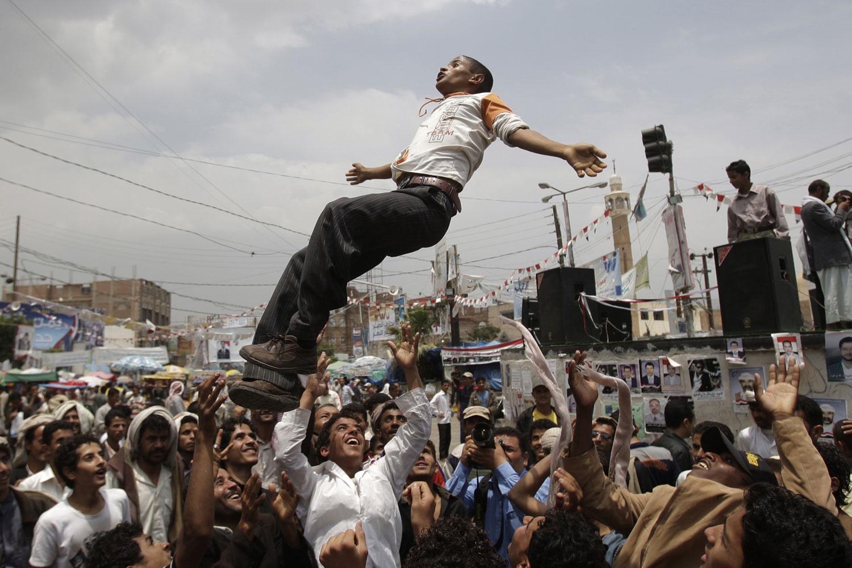 July 7, 2011. Yemeni protestors throw a fellow protester into the air during an anti-government demonstration demanding the resignation of Yemeni President Ali Abdullah Saleh in Sanaa, Yemen.
