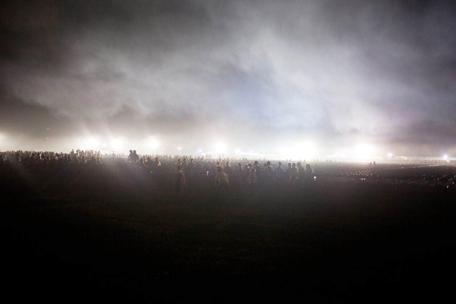 A crowd gathers for a fireworks display in Soma, August 13, 2011.