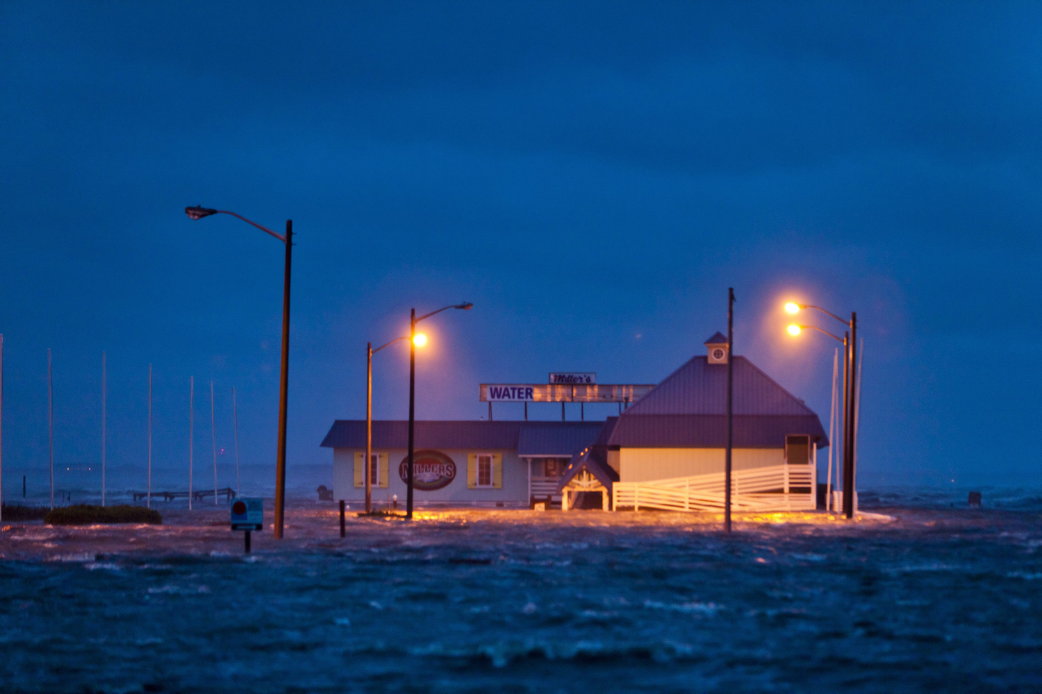 August 27, 2011, Nags Head, North Carolina. The Albemarle Sound floods Millers Restaurant shortly after Hurricane Irene barreled through the Outer Banks.
