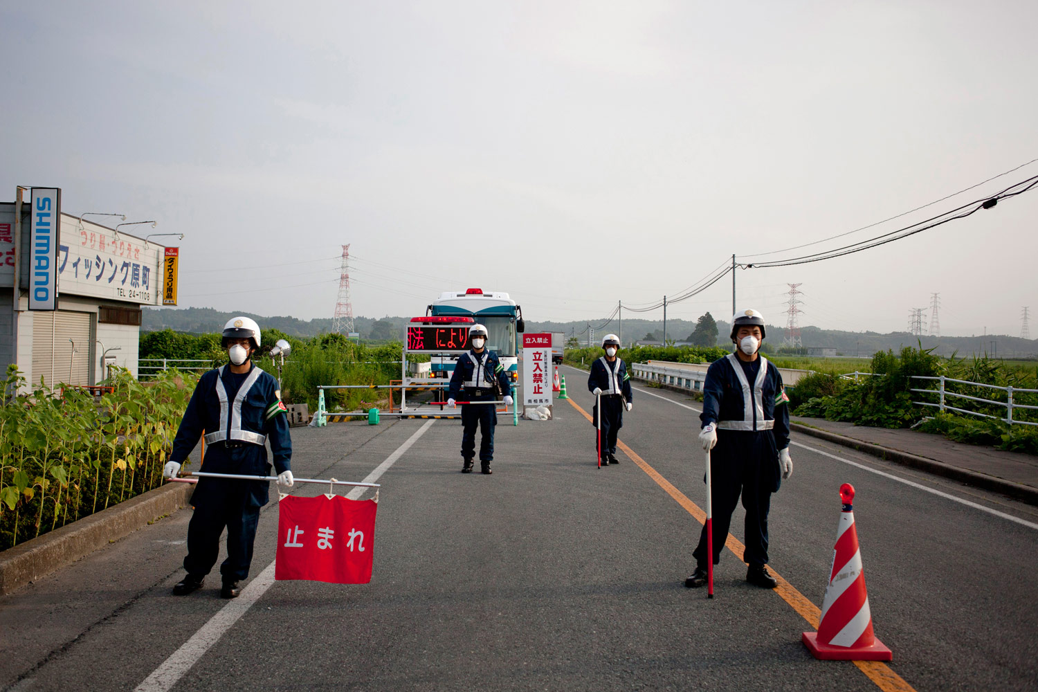 Police stand guard at a roadblock near Minamisoma, preventing access to the exclusion zone.