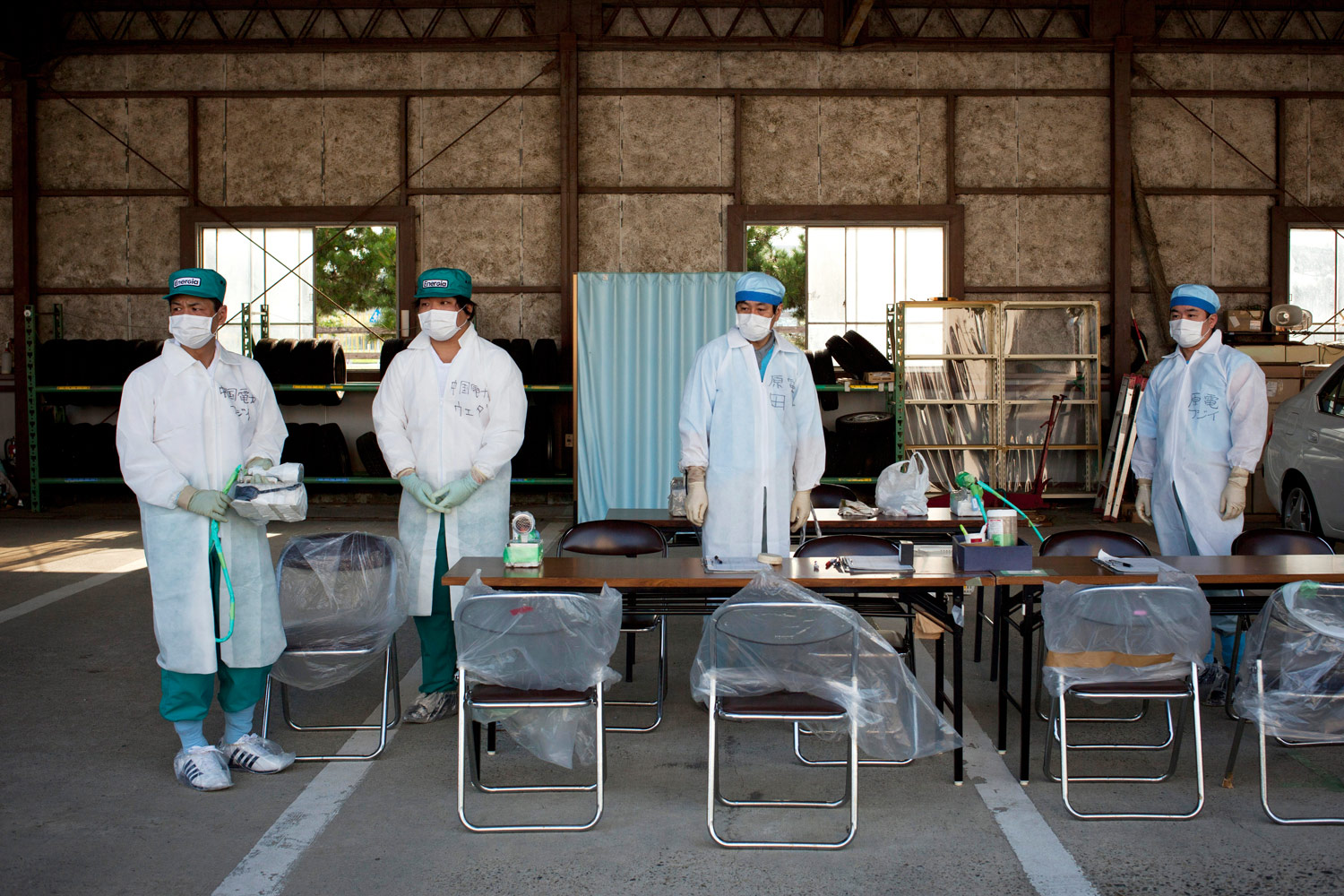 Technicians at a radiation screening center in Minamisoma, August 13, 2011. Most of the people screened had come back to the exclusion zone to retrieve their belongings left behind after evacuating in March.