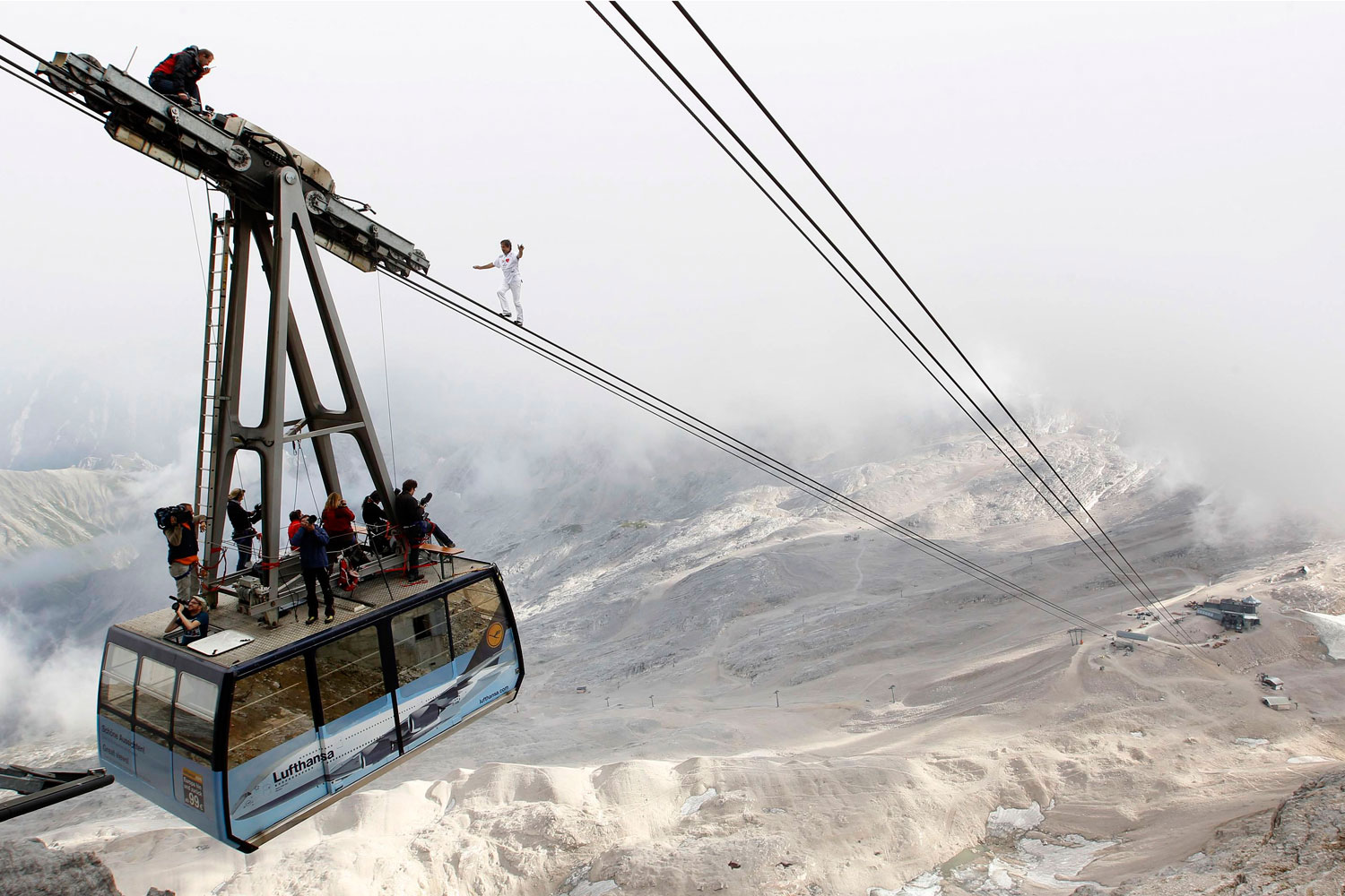 August 20, 2011. Freddy Nock of Switzerland balances on the ropeway of a cable car leading up Germany's 9,718-ft. Zugspitze, near the resort of Garmisch-Partenkirchen. Nock walked the 3,264-ft. cable, breaking his own worldrecord.