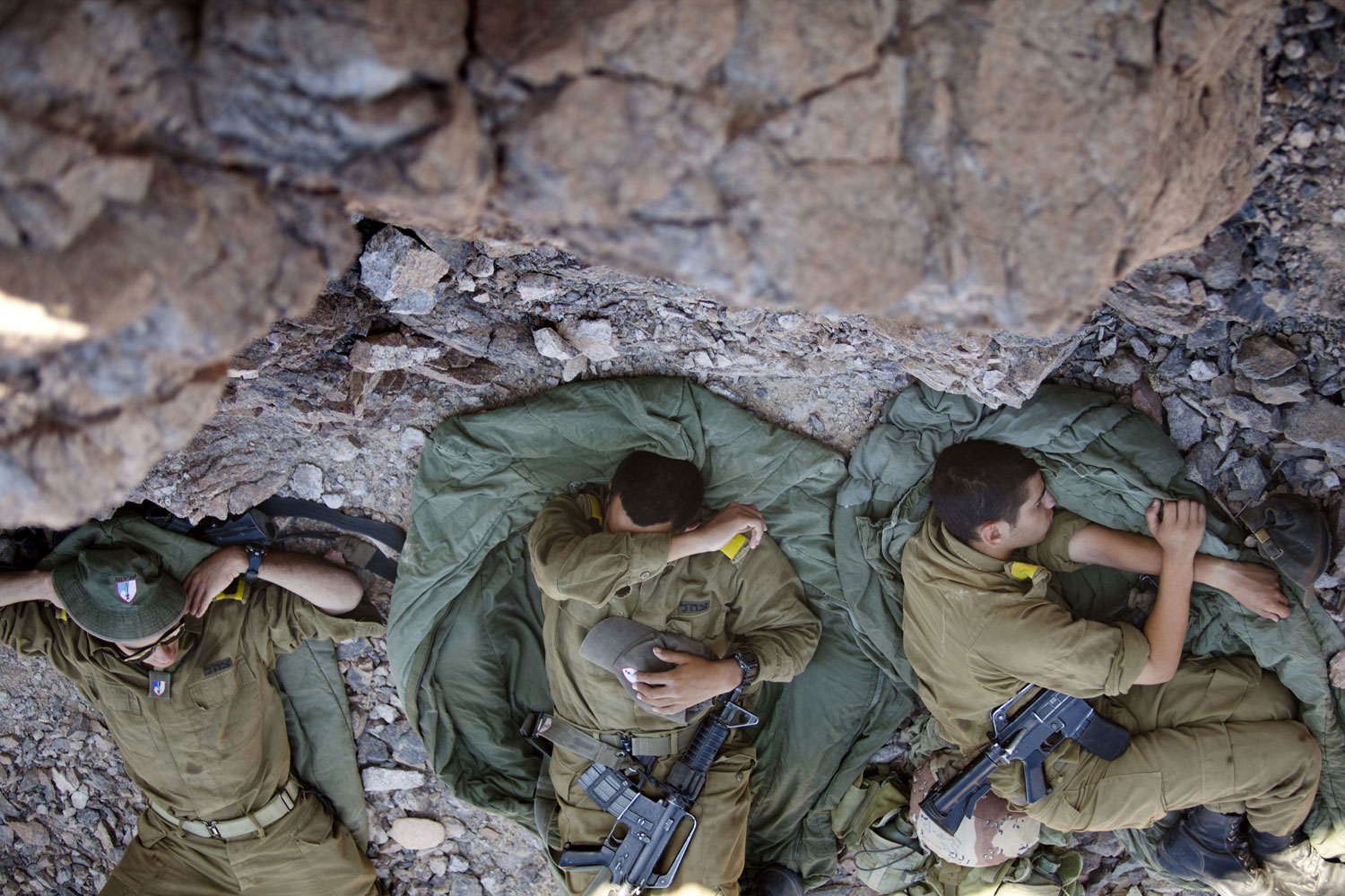 August 19, 2011. Israeli soldiers rest on the border between Israel and Egypt following a series of coordinated roadside attacks against military and civilian targets in Eilat, Israel. The militant group Hamas welcomed the attacks but did not claim responsibility.