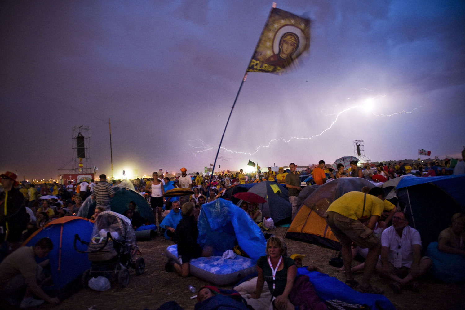 August 20, 2011. A storm illuminates the sky during a vigil in Madrid, part of World Youth Day 2011. Begun by Pope John PaulII in 1985, Catholic World Youth Day events are held every three years in a differentcountry.