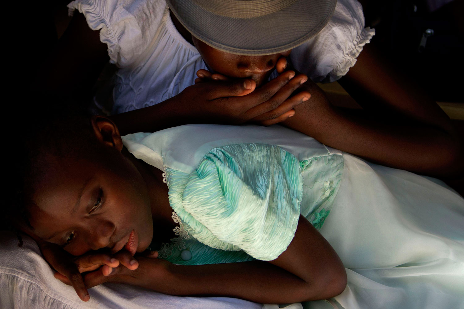 August 20, 2011. Girls rest during a gathering of schools from the Carrefour neighborhood of Port-au-Prince. A year and a half after the devastating earthquake, recovery is still lagging.