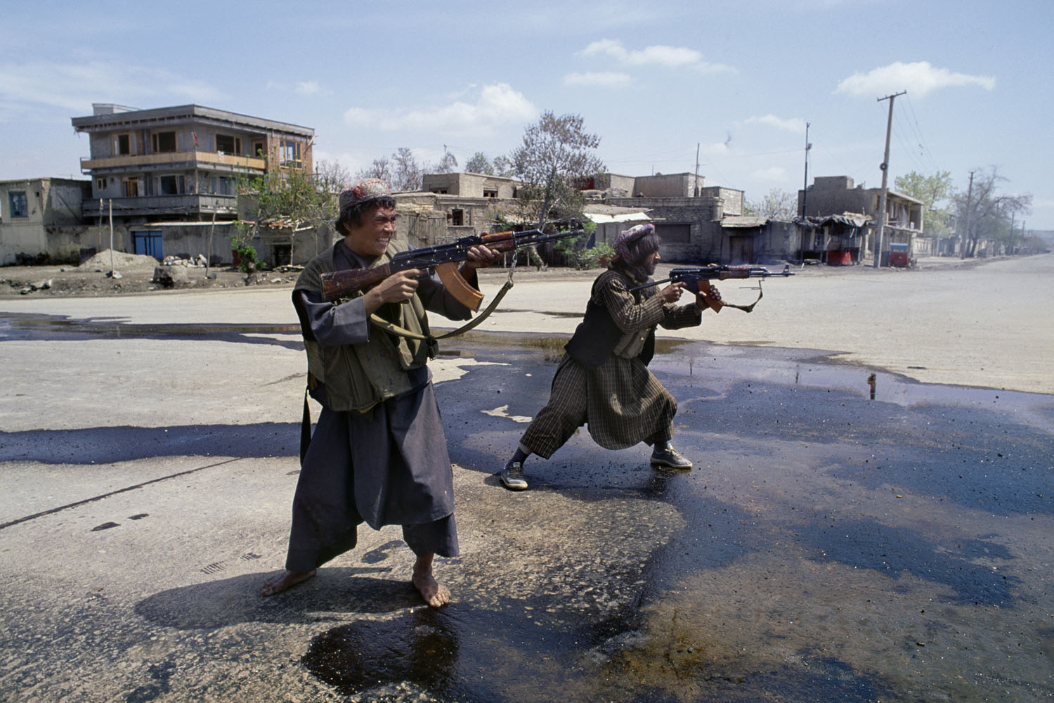 Two Uzbek fighters under the control of Afghan General Abdul Rashid Dostum fire on Hezbi-Islami forces of Gulbuddin Hekmatyar in the SW part of Kabul during the mujahideen takeover of Kabul. April, 1992.