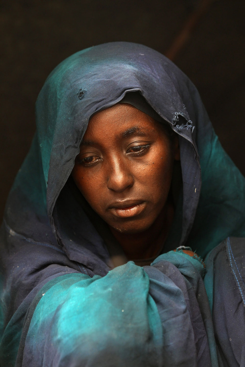 Safia Adem mourns the death of her son Hamza Ali Faysal, 3, in a camp of displaced Somalis within the rubble of the Cathedral of Mogadishu on August 13, 2011 in Mogadishu, Somalia. The malnourished child died of sickness two weeks after fleeing with his family from famine and drought in far southern Somalia. The US government estimates that some 30,000 children have died in southern Somalia in the last 90 days from the crisis.
