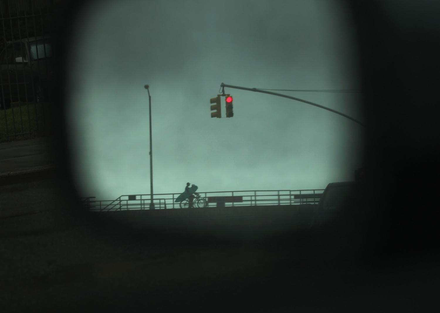 August 27, 2011, New York, NY. A surfer is viewed on his bike through a car mirror in the Rockaways before the arrival of Hurricane Irene. The Rockaways were under mandatory evacuation orders.