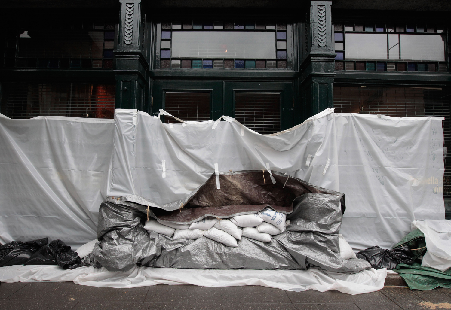 August 27, 2011, New York, NY. A liquor store is covered in plastic and sandbags along the South Street Seaport.
