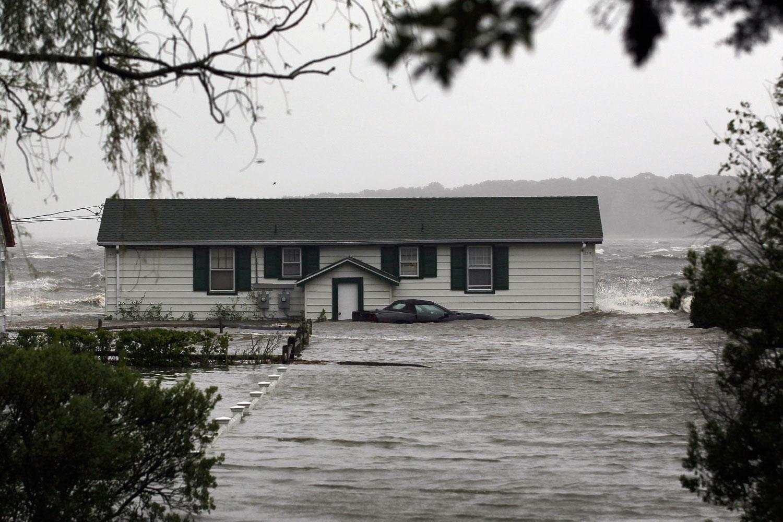 August 28, 2011, Southampton, NY. Waves crash around a home as Hurricane Irene arrives.
