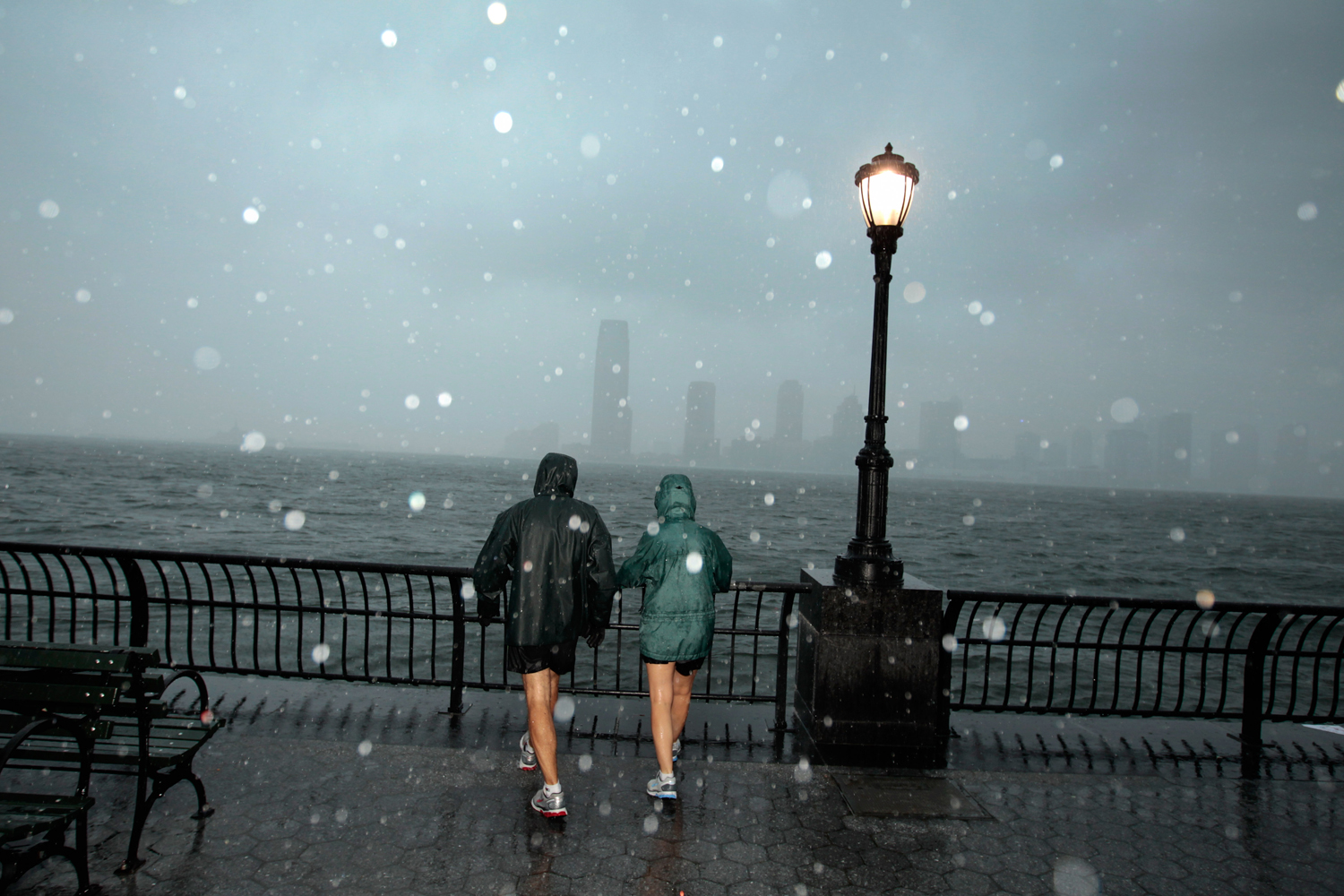 August 28, 2011, New York, NY. SoHo residents Amy Eagle, right, and Rich Thompson take an early morning walk just before high tide along the World Financial Center Esplanade as the effects of Hurricane Irene are still felt in Manhattan.