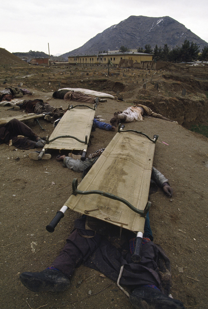 Bodies of dead Hezb-e Wahdat Shia fighters are dumped on the ground in western Kabul, presumably killed by opposition Sunni fighters. Hundreds of Hazara Shiite civilians were killed by government factions in the nearby Afshar district. March, 1993