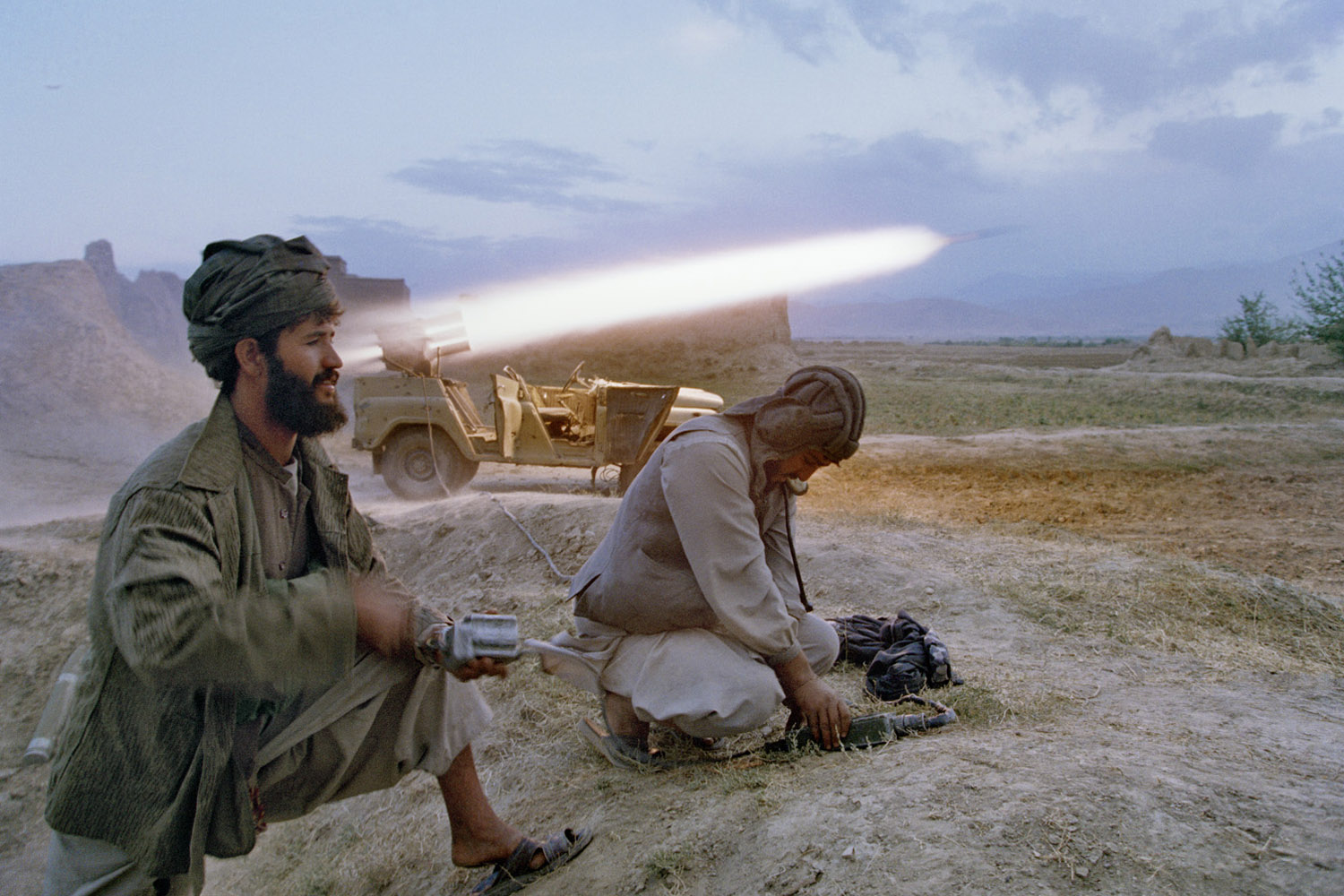 Taliban soldiers fire a rocket at retreating forces of Ahmed Shah Massoud, north of Kabul. September, 1996