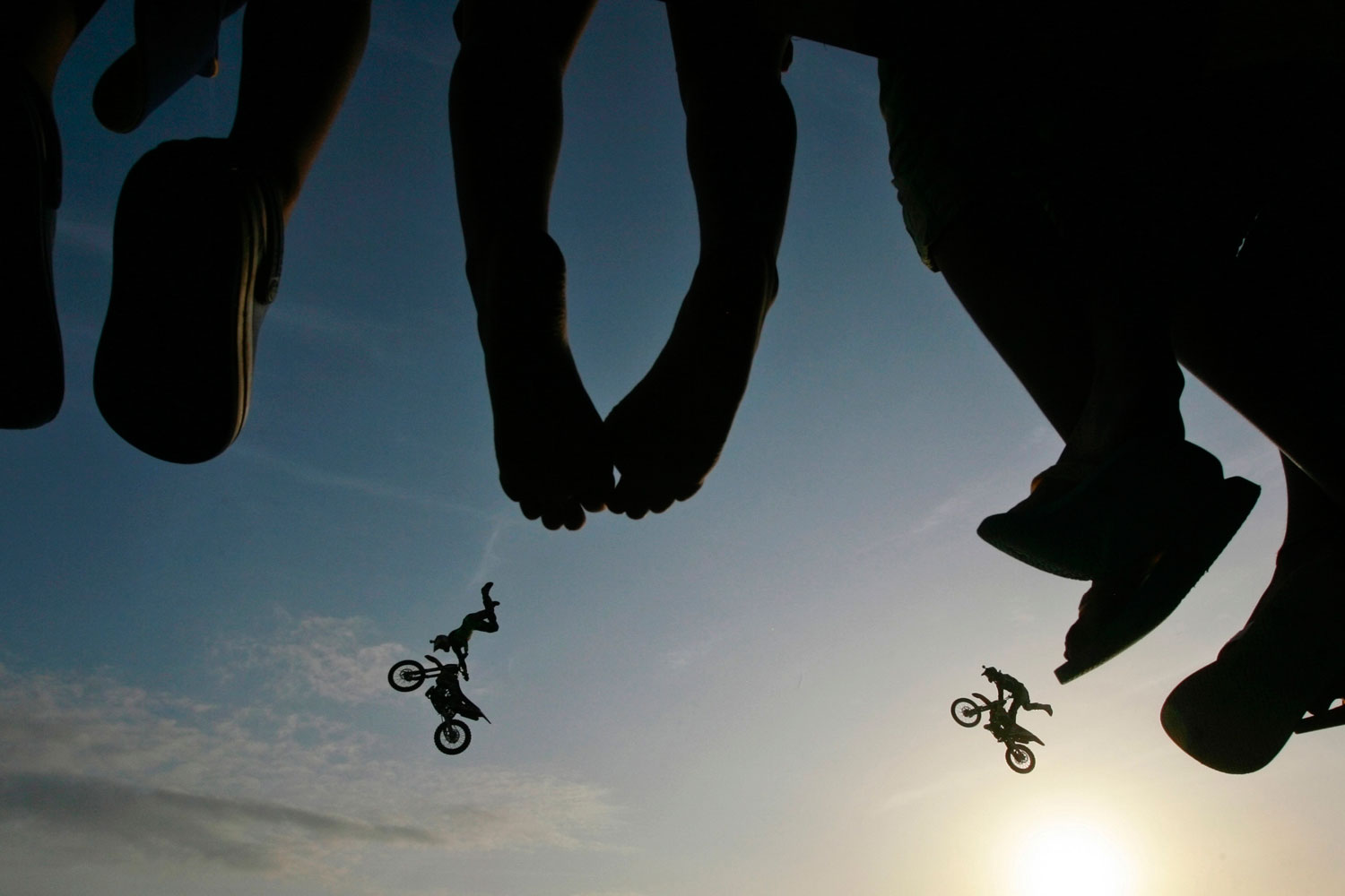 July 30, 2011. Spectators watch as freestyle motocross stunt riders from Red Bull X-Fighters perform during their show at Galle Face Green in Colombo.