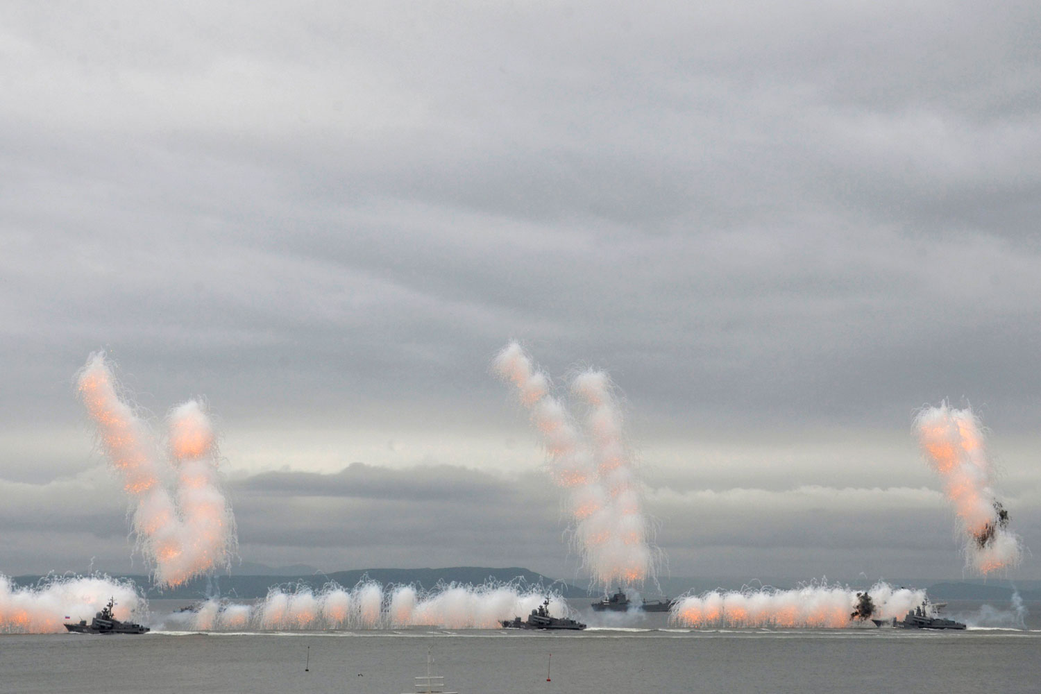 July 31, 2011. Russian warships fire during a naval parade in the far eastern port of Vladivostok.