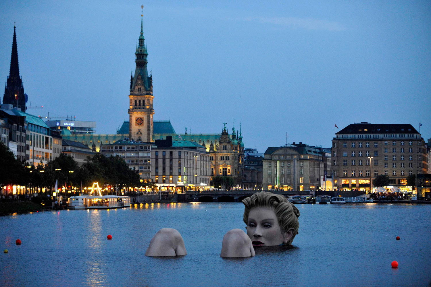 August 3, 2011. A 'mermaid' sculpture created by Oliver Voss is seen in the late evening hours on Alster lake in Hamburg. The four-metre-high sculpture dubbed  Riesen-Nixe  (grand mermaid) or  Badenixe  (bathing beauty) will be on display until August 12.