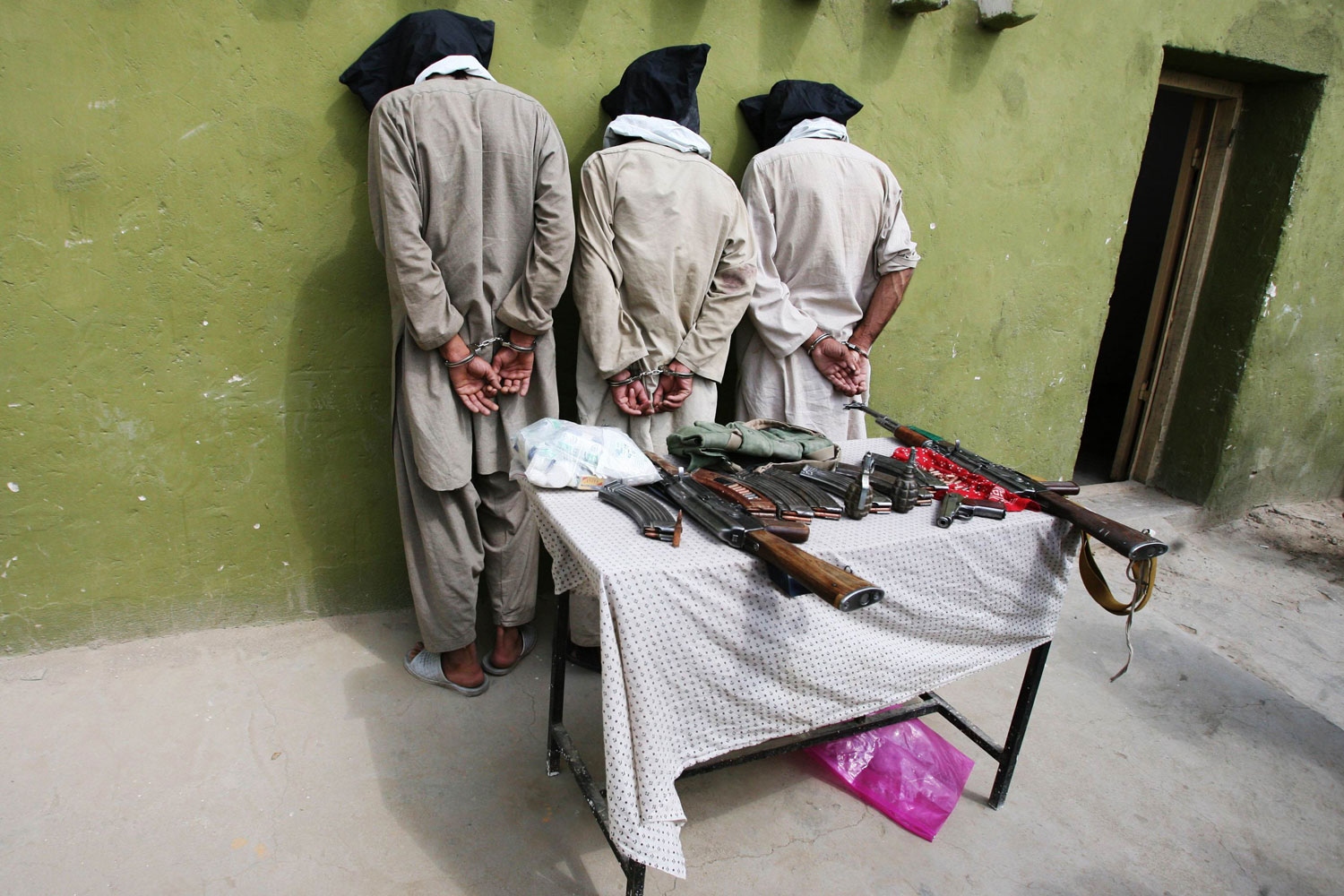 August 25, 2011. Three captured Taliban insurgents are presented to the media in Ghazni province, Afghanistan.