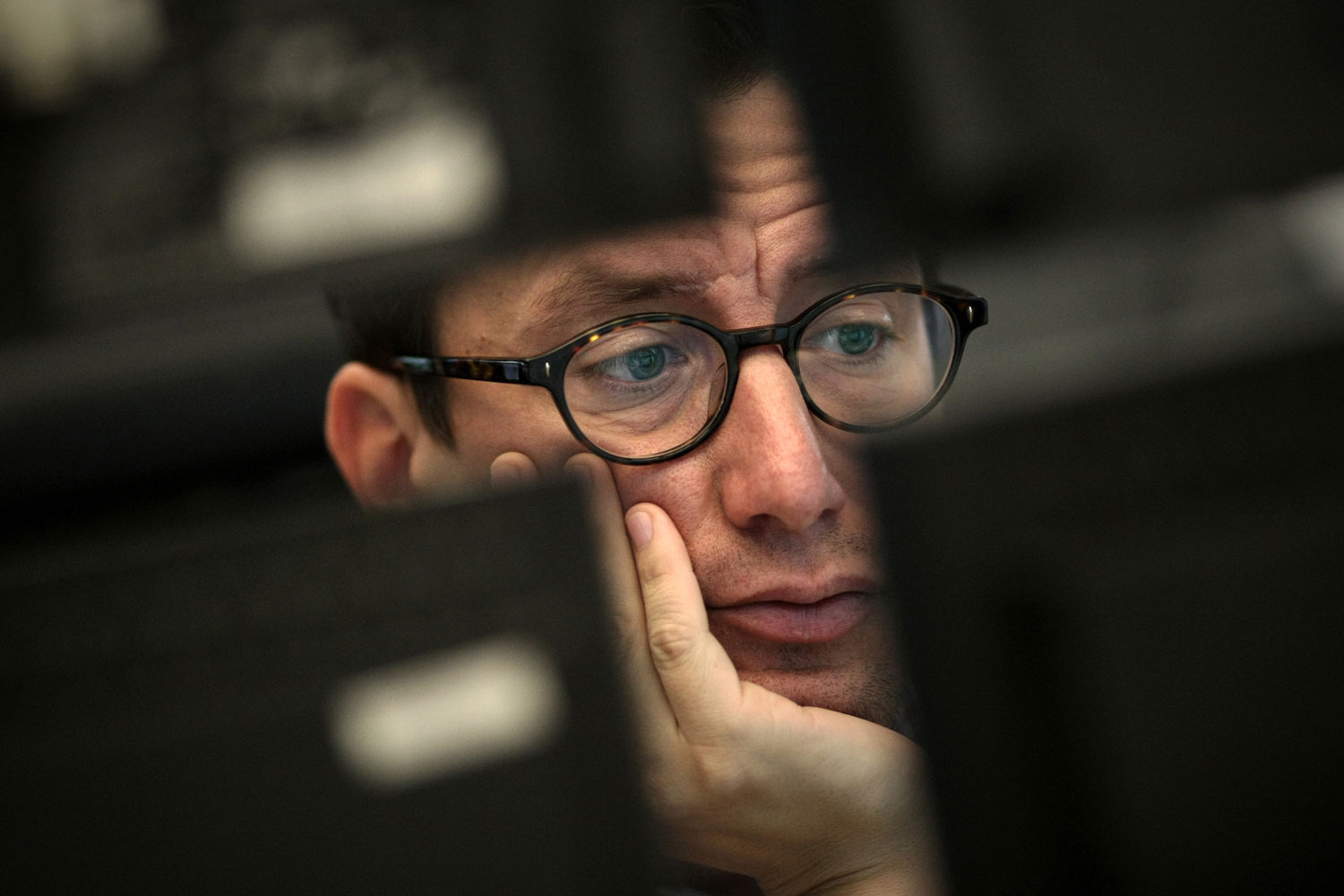 A trader views his monitors at the stock exchange in Frankfurt/Main, Germany, August 9, 2011.