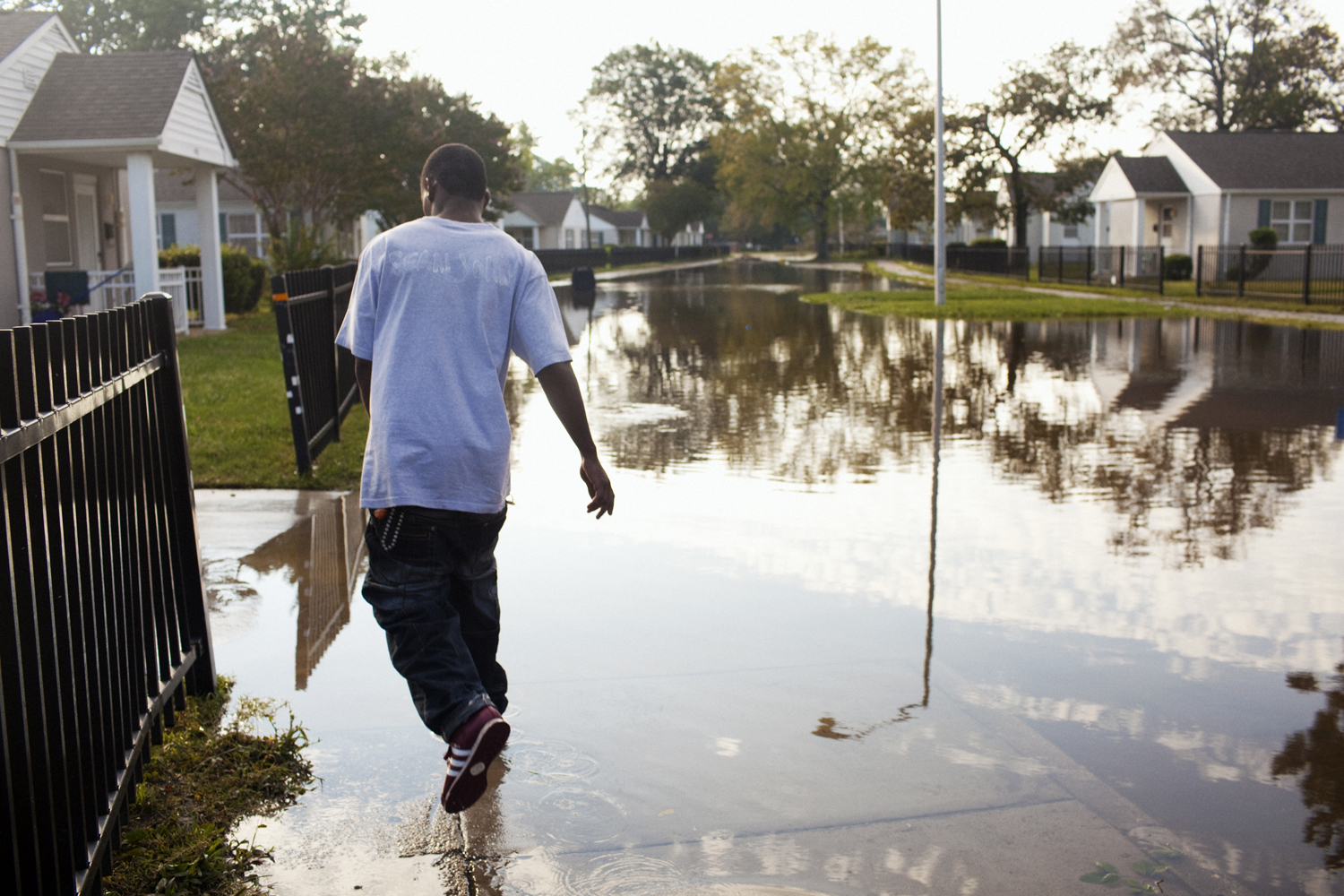 August 28, 2011, Portsmouth, Virginia. A young man walks through a flooded street on Sunday after the storm.