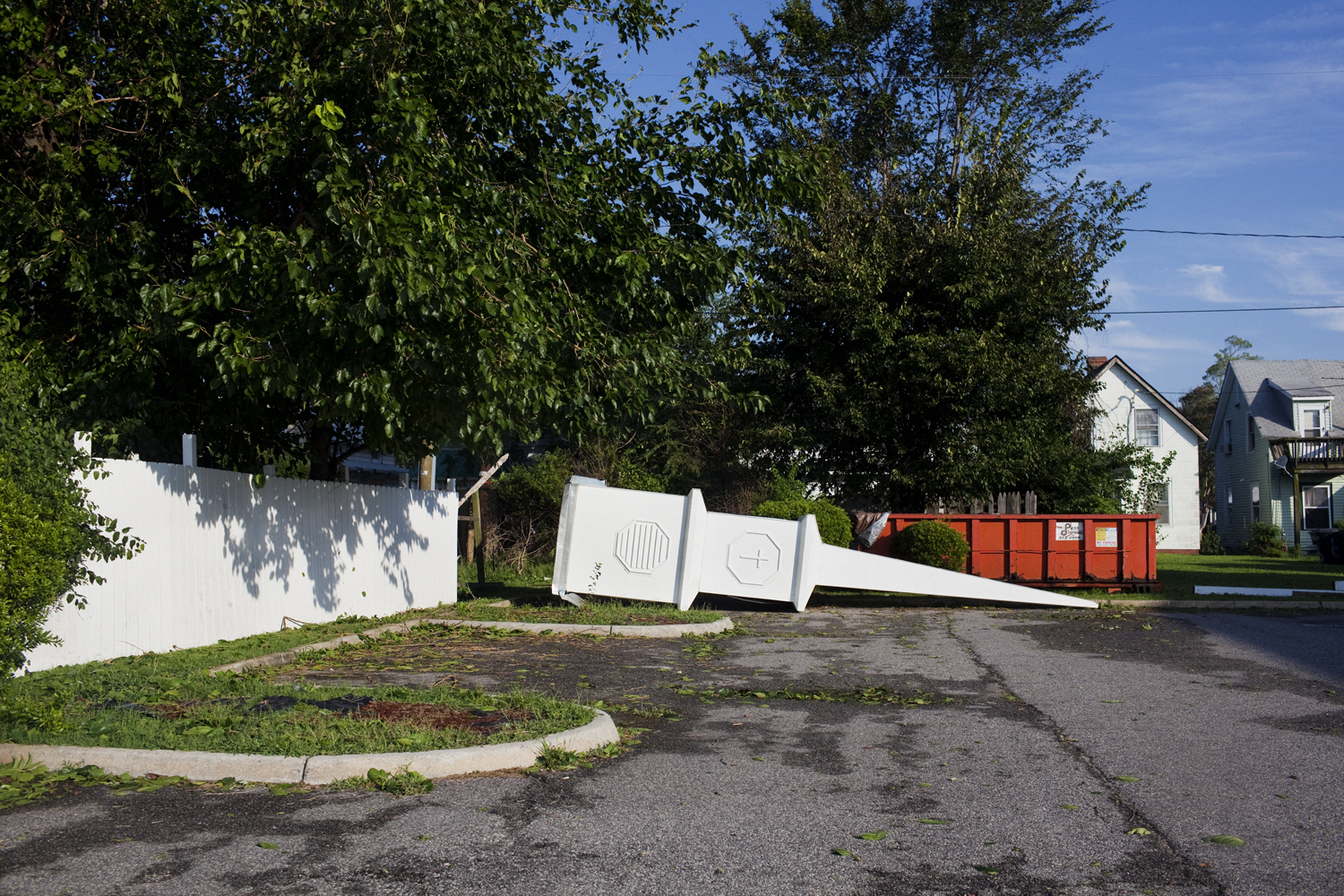 August 28, 2011, Portsmouth, Virginia. A steeple lies on the ground next to a church on Sunday.