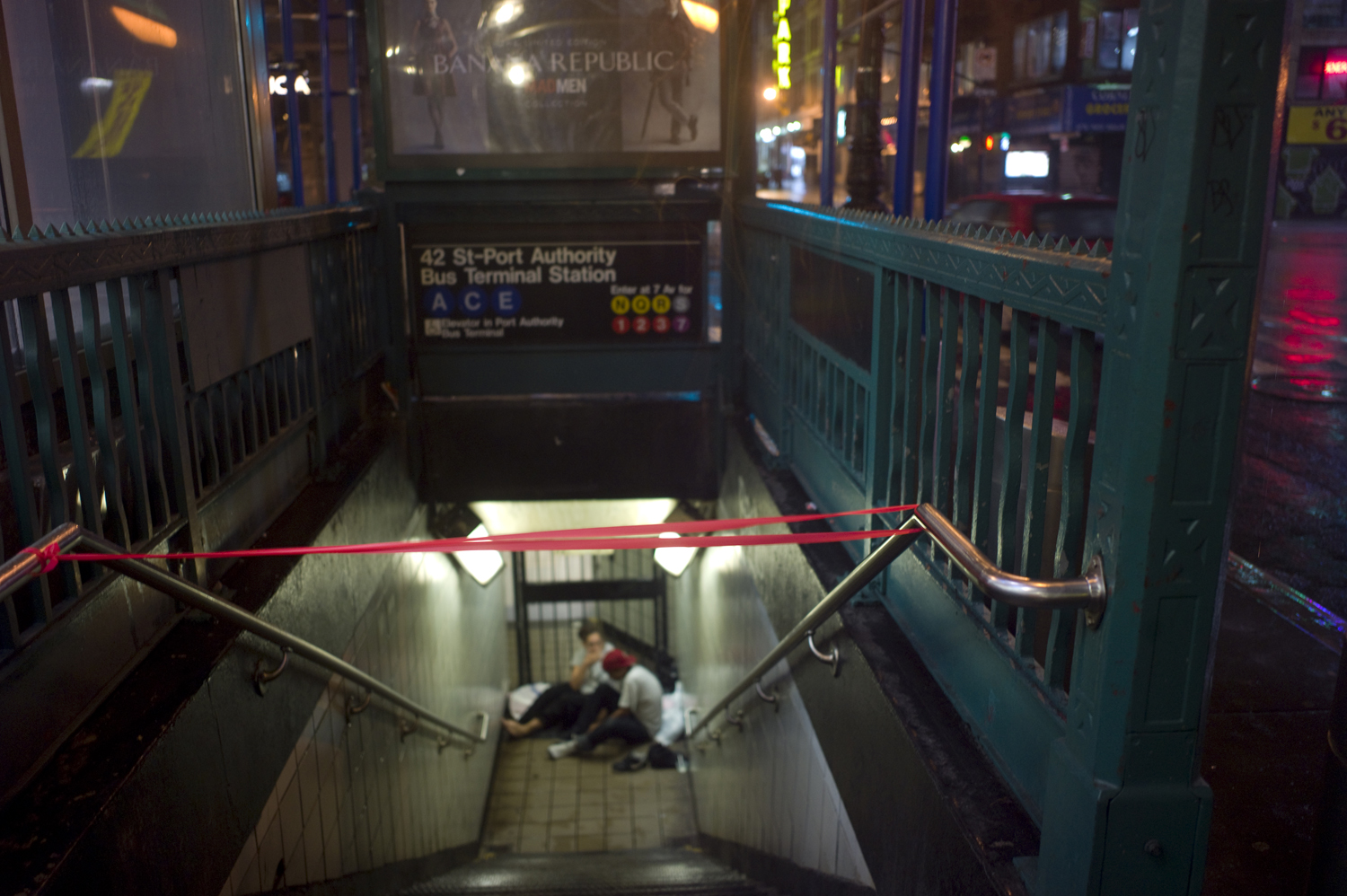 August 27, 2011, New York, NY. Homeless New Yorkers sleeping in a subway entrance near Times Square.