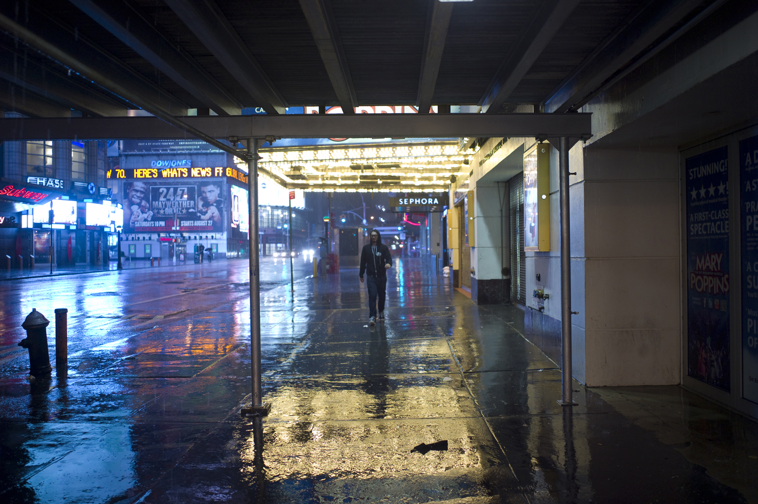 August 27, 2011, New York, NY. A lone man walks through an empty part of Times Square late in the evening during the storm.