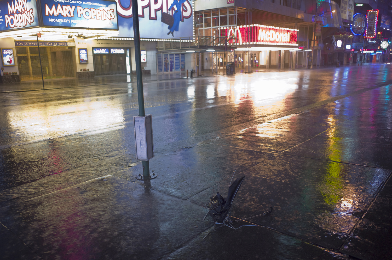 August 27, 2011, New York, NY. A crushed umbrella in a deserted Times Square during Hurricane Irene.