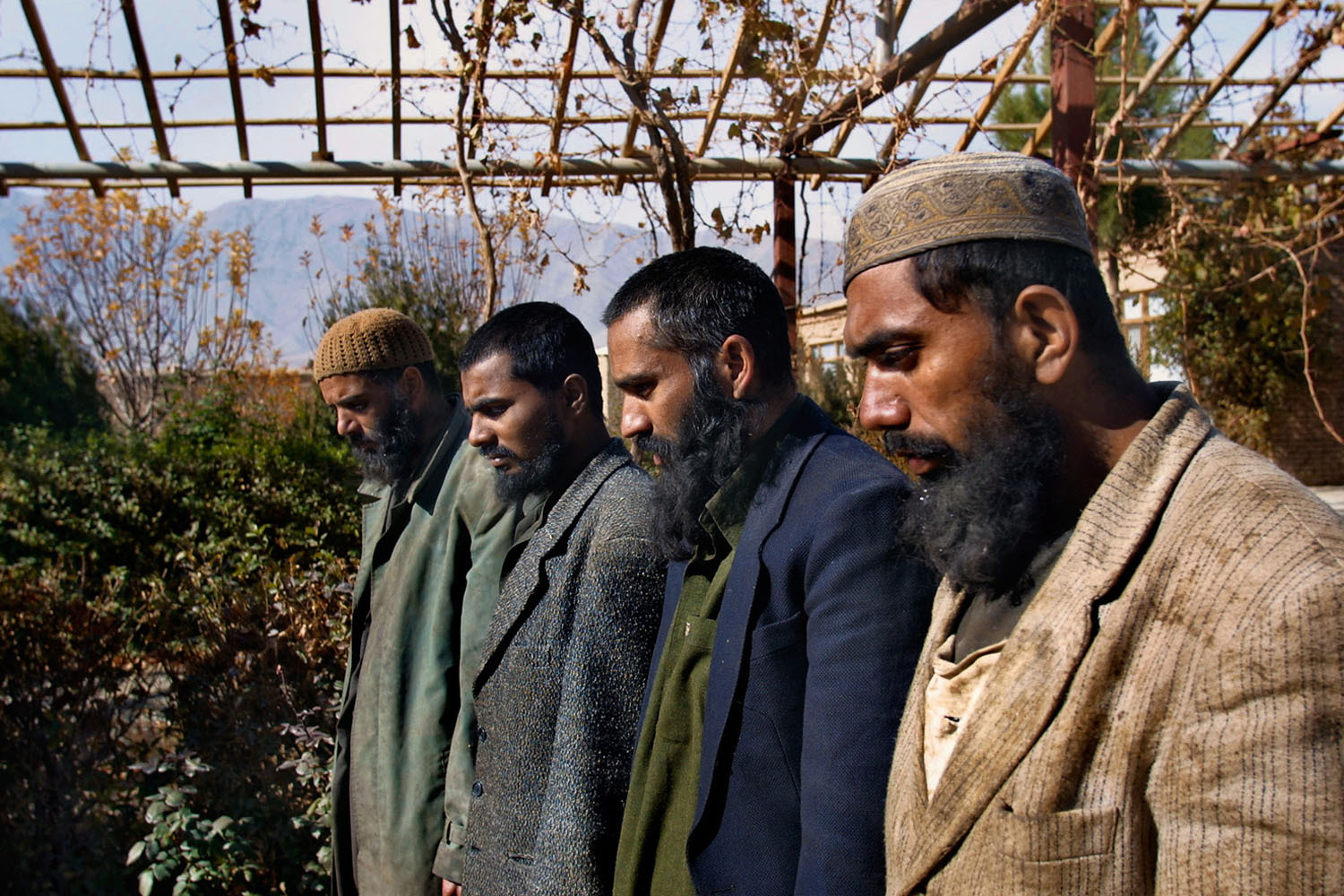 Pakistani Taliban prisoners are interviewed after being captured outside of Kabul while fighting Northern Alliance troops. December, 2001