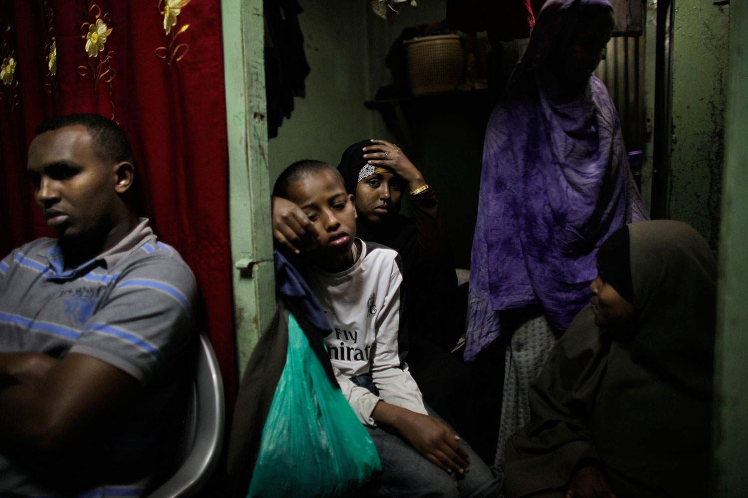Nairobi, Kenya. August. 4, 2010.                               Relatives of alleged Somali pirate Ahmed Adan Warsame, who is currently awaiting trial in Germany after the hijack of a German vessel in the Gulf of Aden, sit in their home.