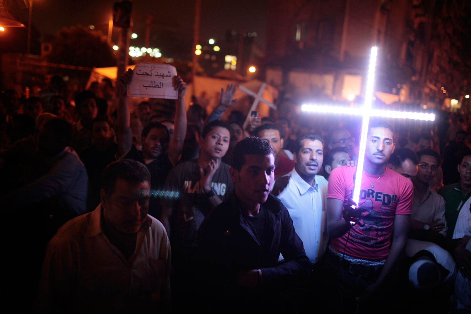 Cairo, Egypt. May 19, 2011.                                In mid May, tensions between Muslim groups and Coptic Christians peaked, where clashes led to deaths and burning of churches. I shot this during a sit-in of Coptic Christians.