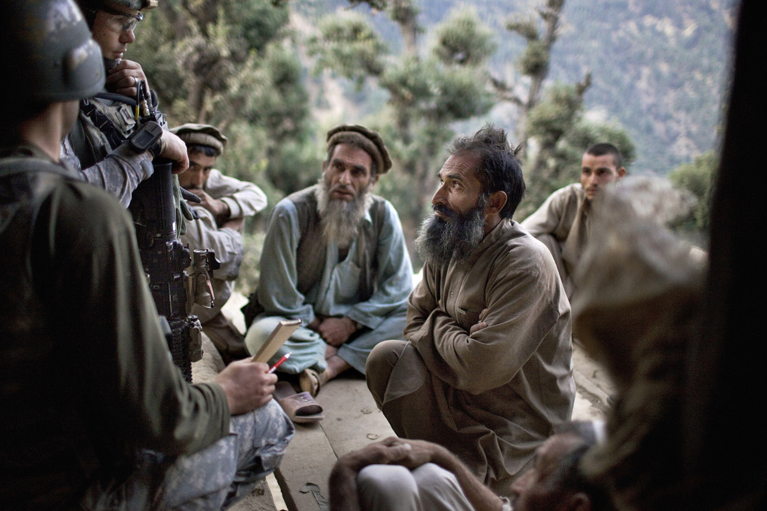 US Army soldiers question members of a family about Taliban presence during a large aerial assault operation along the Pech River in Kunar province's Shuryak Valley. September, 2009
