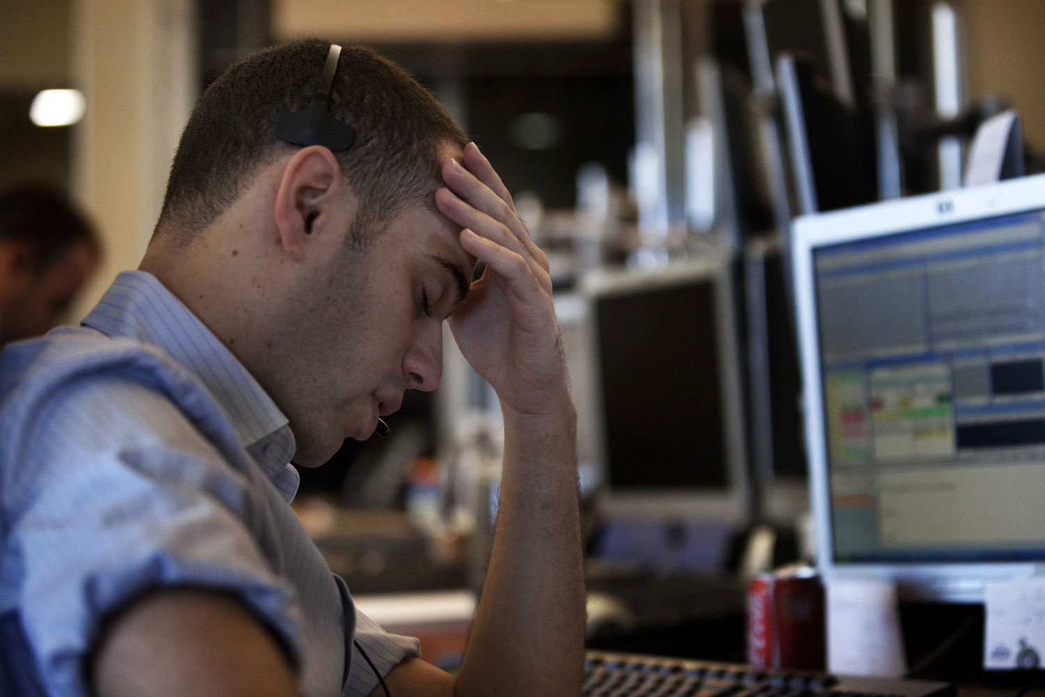 Israeli stock market traders work at their office in the Meitav investment house in Tel Aviv, August 8, 2011 a day after key Israeli stock indices fell around seven percent and trading on the Tel Aviv stock exchange was temporarily halted after news of a US credit rating downgrade.