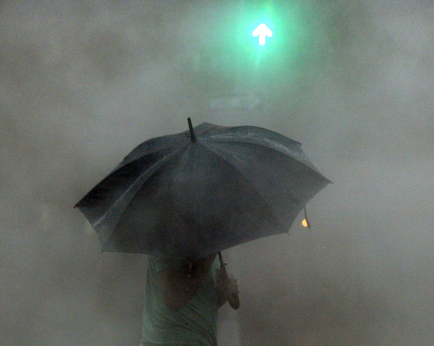 August 28, 2011, New York, NY. A man walks in the early morning rain.