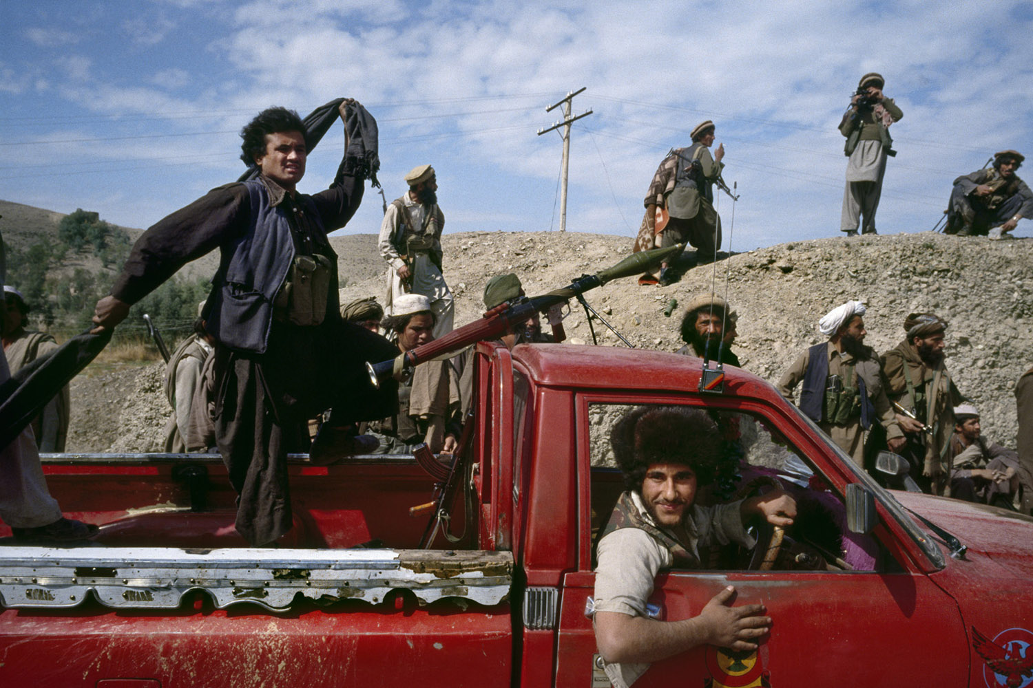 Afghan mujahideen fighters move toward the front line during the battle for Jalalabad. March, 1989