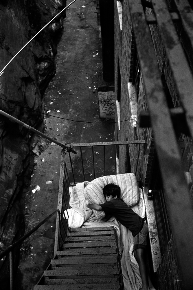 Sleeping on the fire escape, from Bronx Boys (FotoEvidence, 2011) by Stephen Shames.