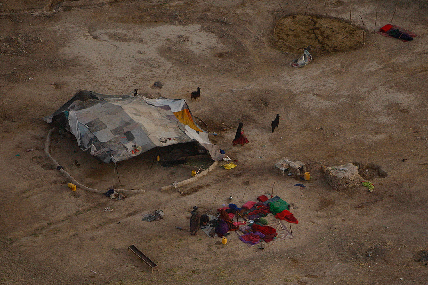July 29, 2011. Nomads are seen gathering around their tent from a medevac helicopter of the U.S. Army's Task Force Shadow  Dust Off  in Kandahar, Afghanistan.