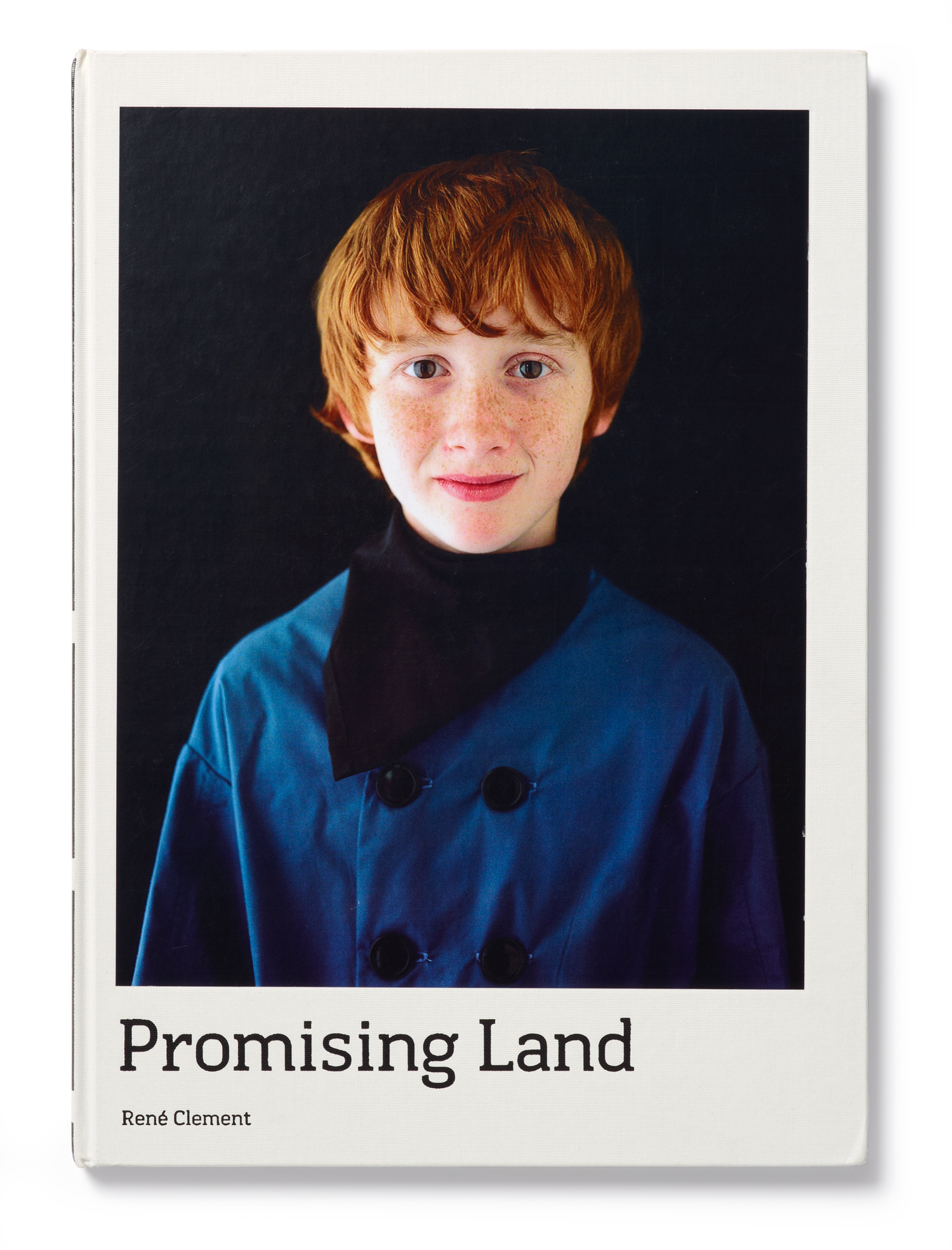 Cover of Promising Land a book by Rene Clement documenting Orange City, Iowa and its Dutch roots.