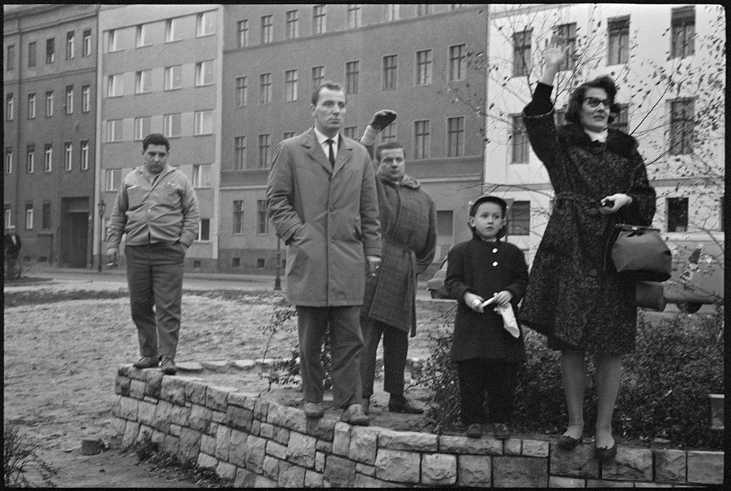 Looking into East Berlin, family members from the west wave to one another near the French sector of East Berlin, November 1961