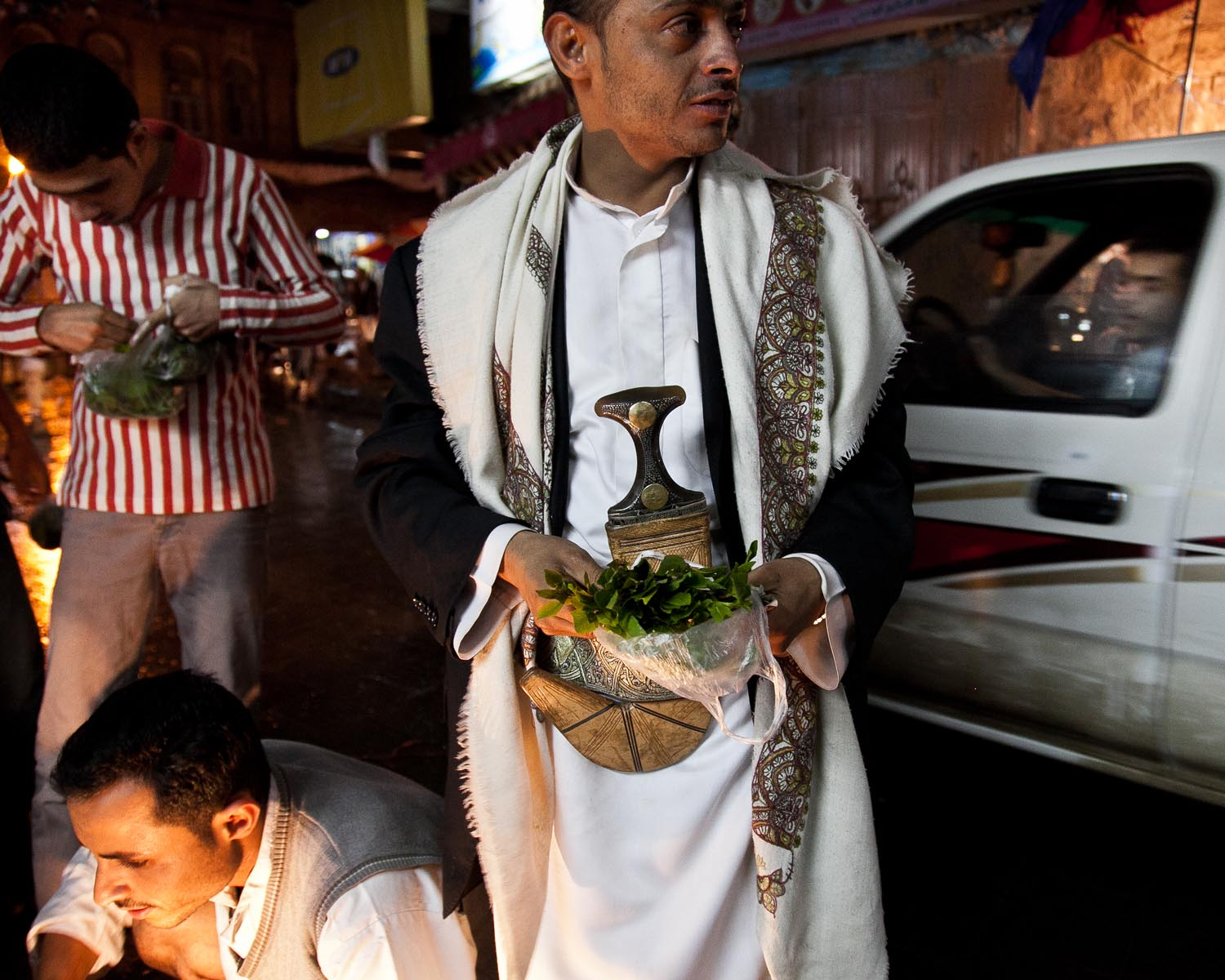In Sana'a, a man carries a bundle of khat, a leaf chewed as a stimulant. August 2010.
