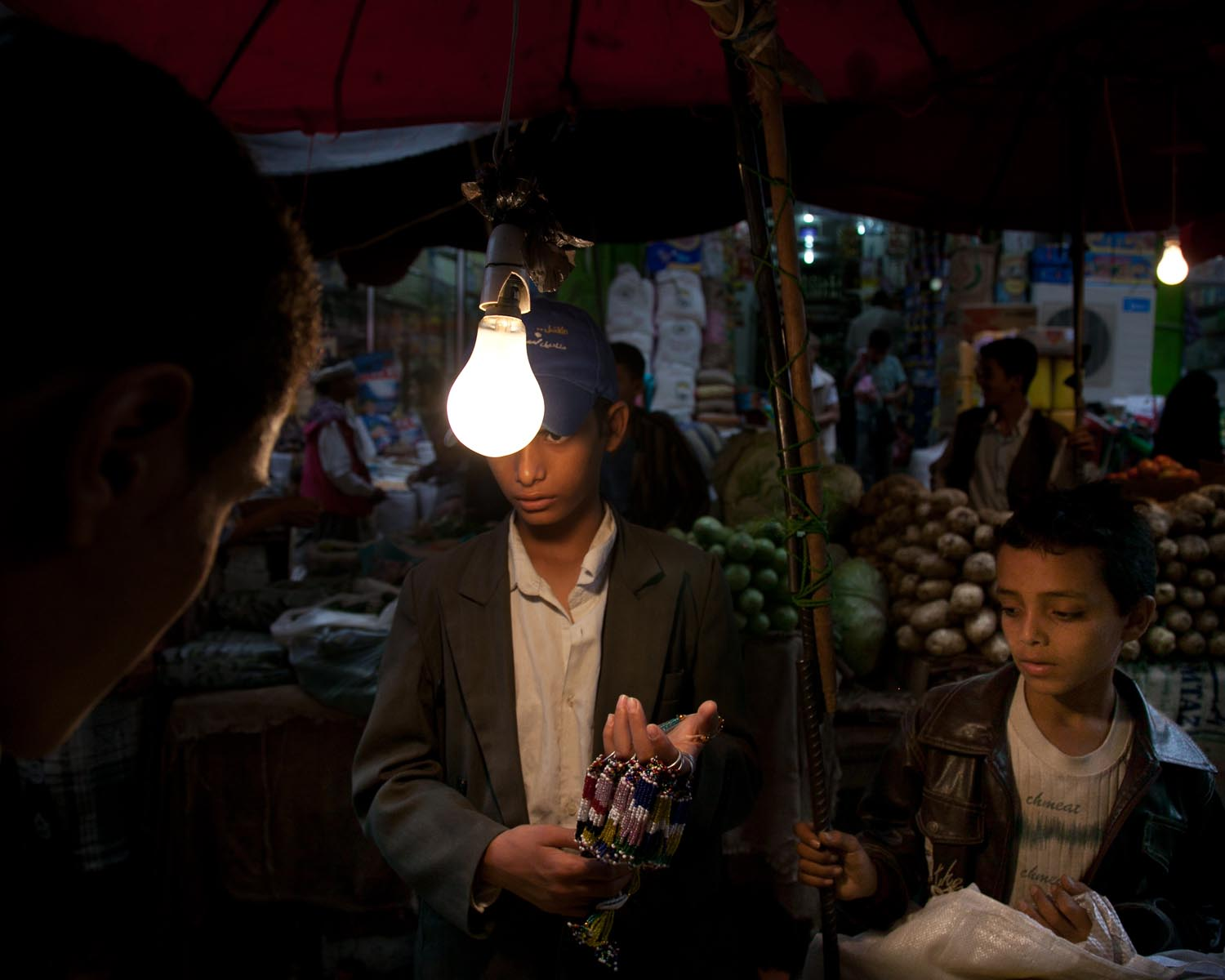 Children sell necklaces at a market in the southern city of Taiz. August 2010.