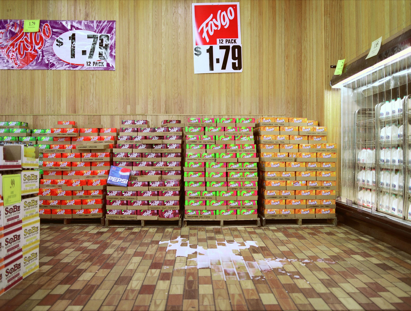 Kenosha WI, 2003                                The employee-run big box store Woodman's, in Wisconsin. I returned years later and asked to photograph with a large format camera. They were extremely accommodating and later one employee explained, 'Someone made a photograph of near the milk section which was printed in the Chicago Tribune.' I smirkingly did not explain I was the author, content in the fact that taking the photograph helped make the store a lot more lenient on their policy of photographing in the store.