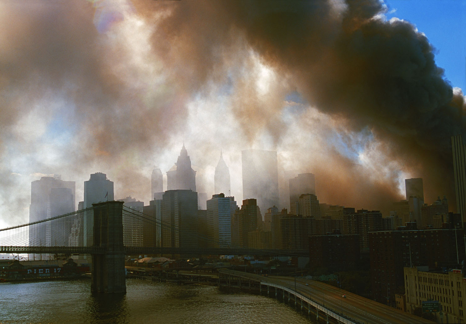 New York, NY, September 11, 2001. View from the Manhattan bridge towards the Brooklyn Bridge and downtown Manhattan during the aftermath of World Trade Center attacks.