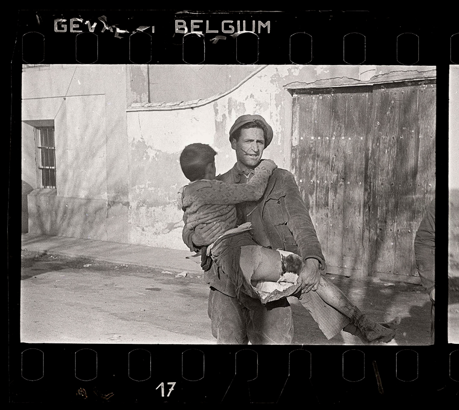 Man carrying wounded boy, Battle of Teruel, Spain, December 1937