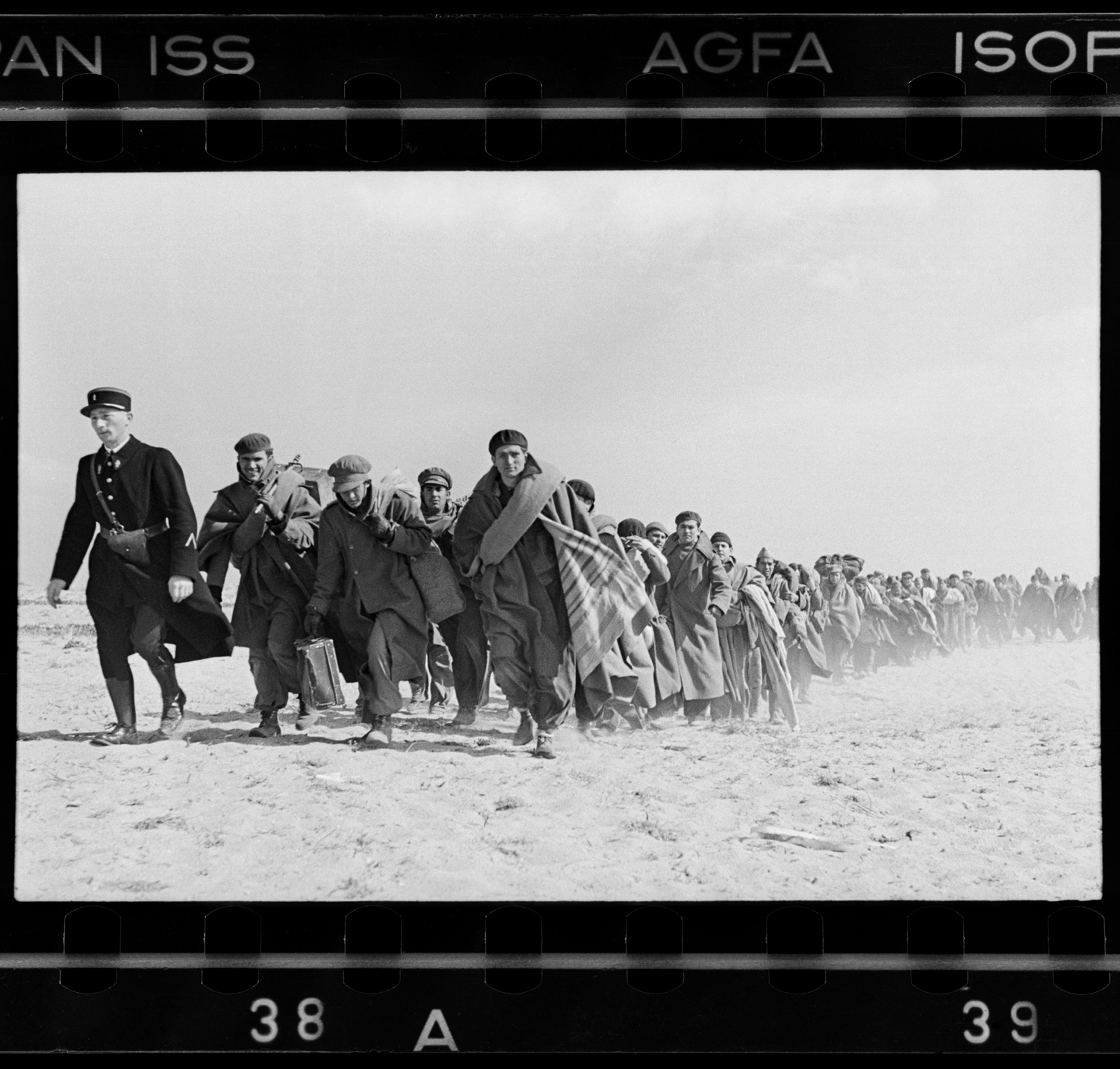 Spanish Republican being led down the beach to a French internment camp, Le Barcarés, France, March 1939