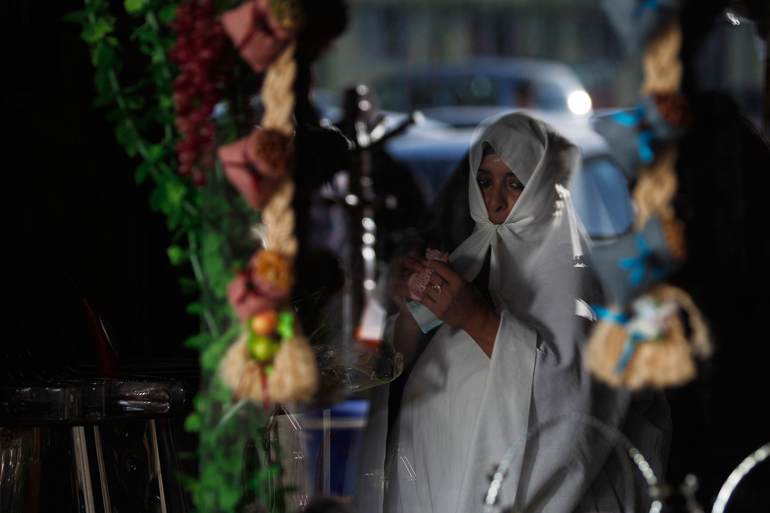 July 29, 2011. A Libyan woman is seen through a store window as she shops at a market in downtown Tripoli, Libya. A rebel special forces member accused fellow Libyan rebels of killing the movement's military chief, pointing to a potentially major split in the ranks of the opposition battling Moammar Gaddafi.
