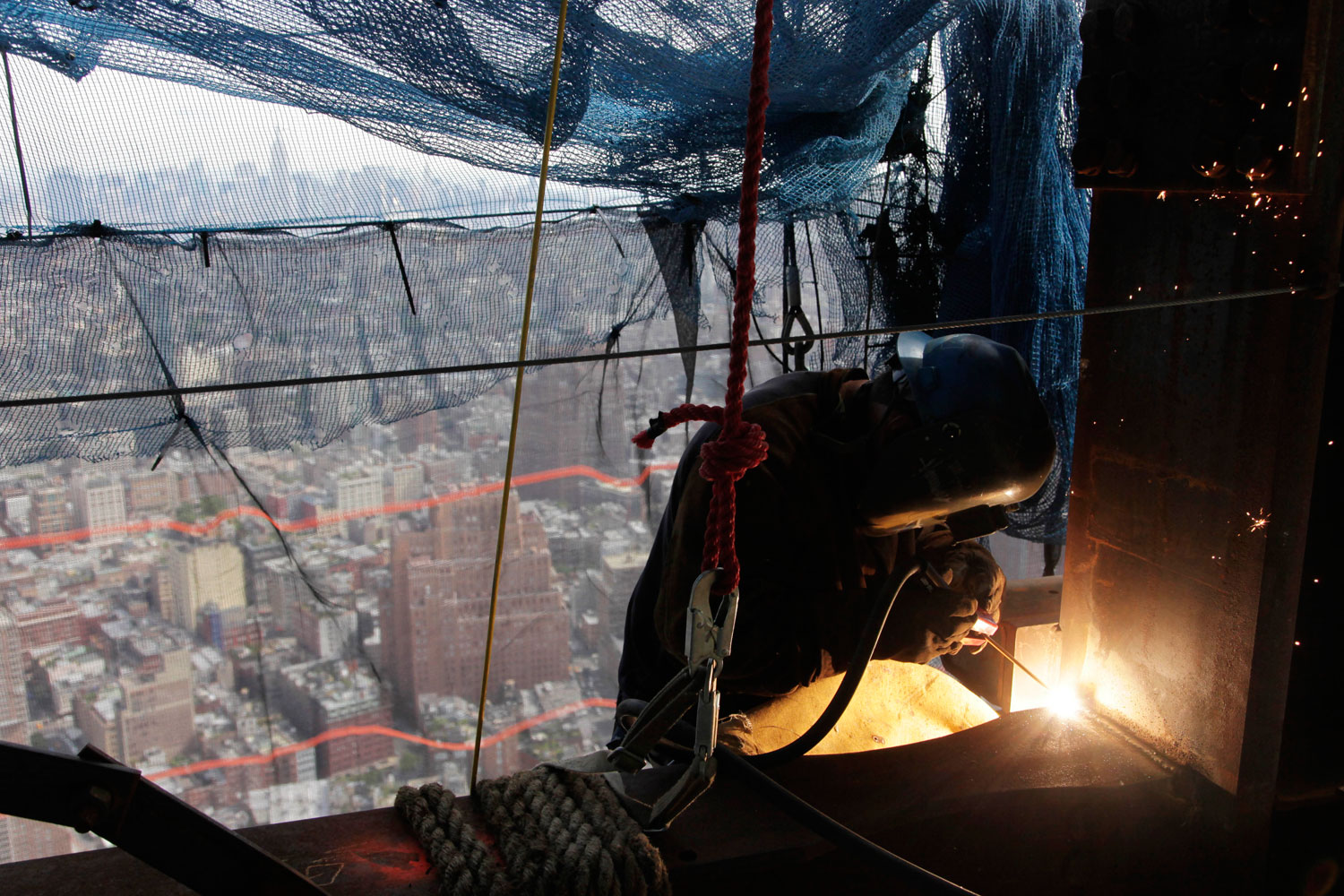 August 24, 2011. A welder works on an upper floor of One World Trade Center, New York. The tower is now built up to the 80th floor.