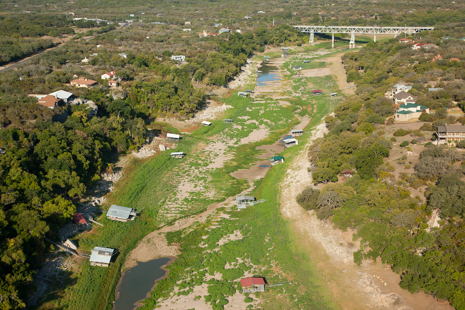 Boat docks sit on the dry bed of the Pedernales River in Texas.