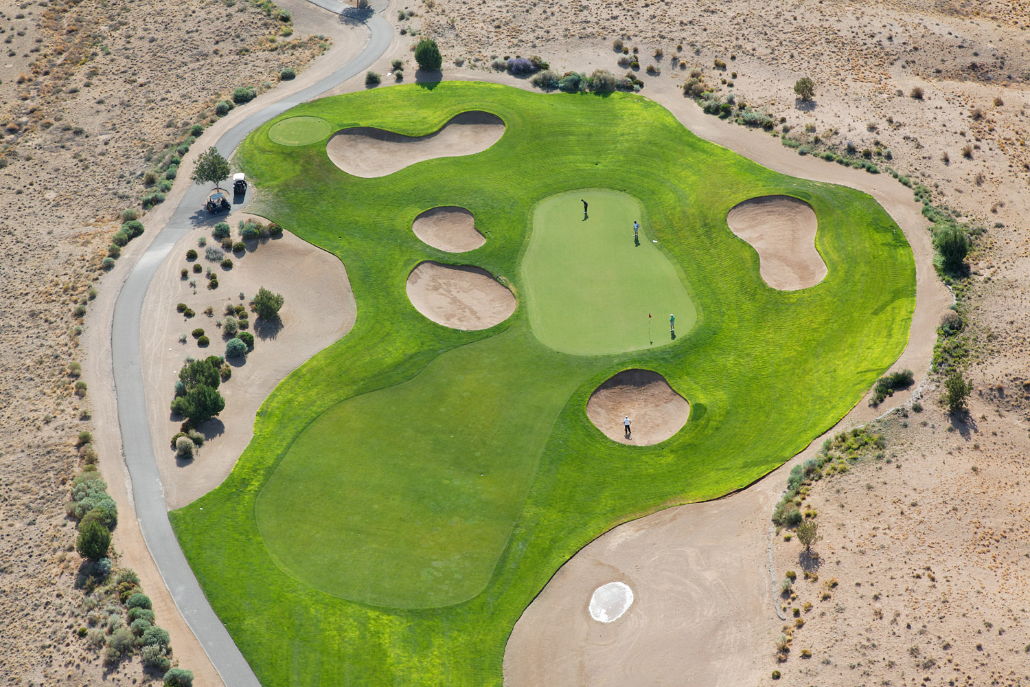 Golf courses in the New Mexico desert require large amounts of water to remain green. As drought becomes more common, tensions increase over water usage.